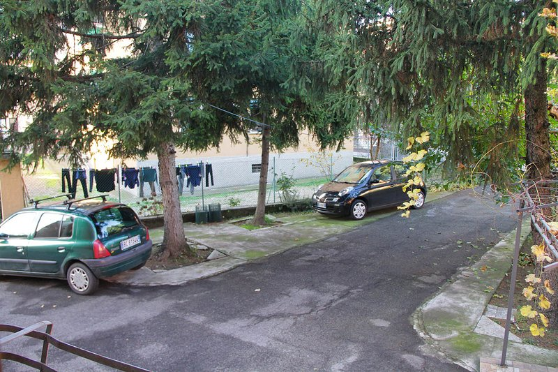 Parking spaces within the enclosed courtyard.