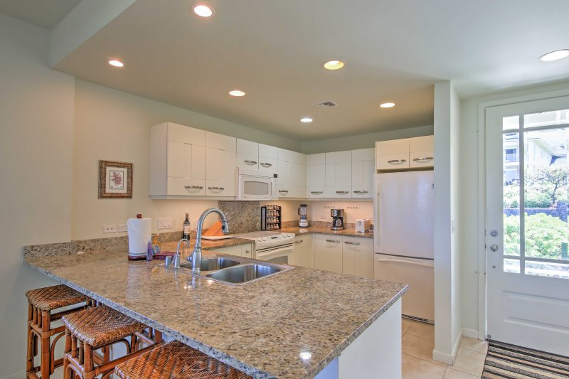 Enjoy the company of your guests sitting at the kitchen bar area while you prepare meals in the kitchen.