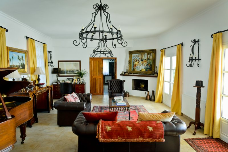 Spacious ornate lounge and dining room with doors opening onto the pool terraces.