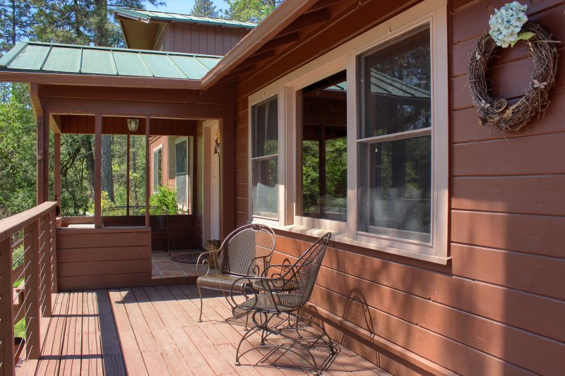Front porch leads to wrap-around deck
