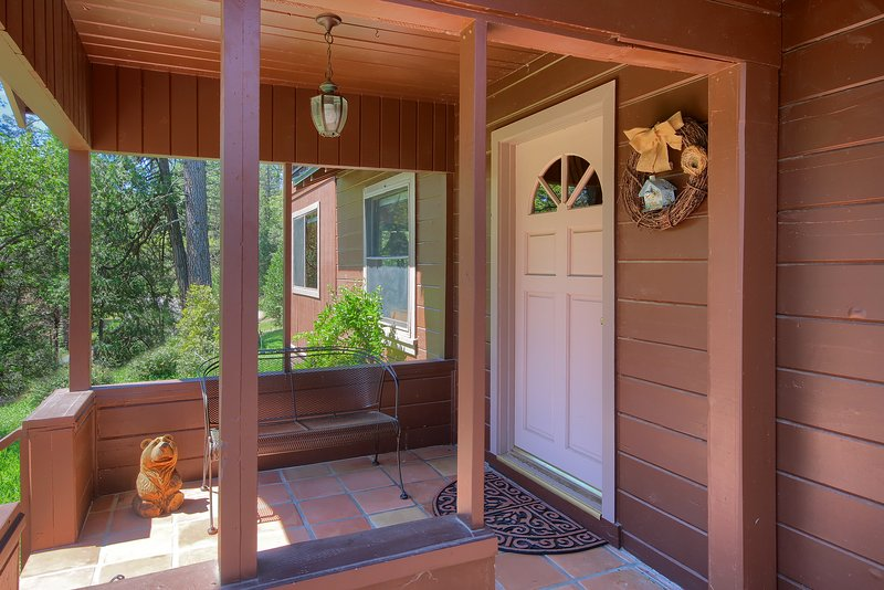 Front porch with love seat