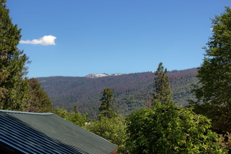 View of Shuteye Peak (and roof of cottage) from deck