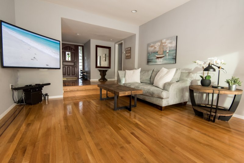 Living Room, 65' OLED TV. Hand made coffee and end tables.