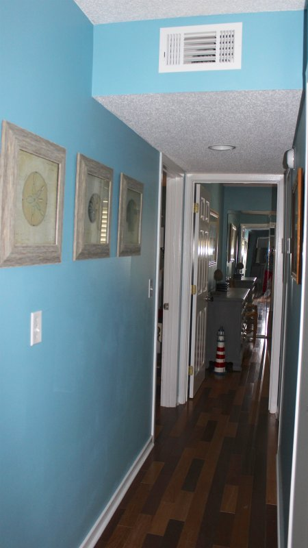 Step down the hall to the laundry area and the two bedrooms.