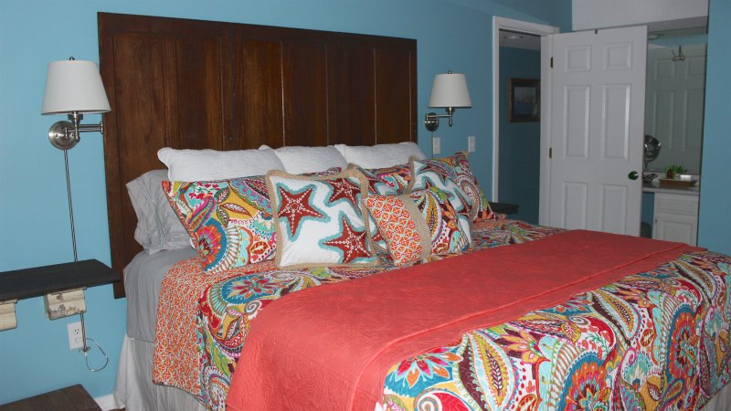 The headboard is made from reclaimed wood from a historic church!