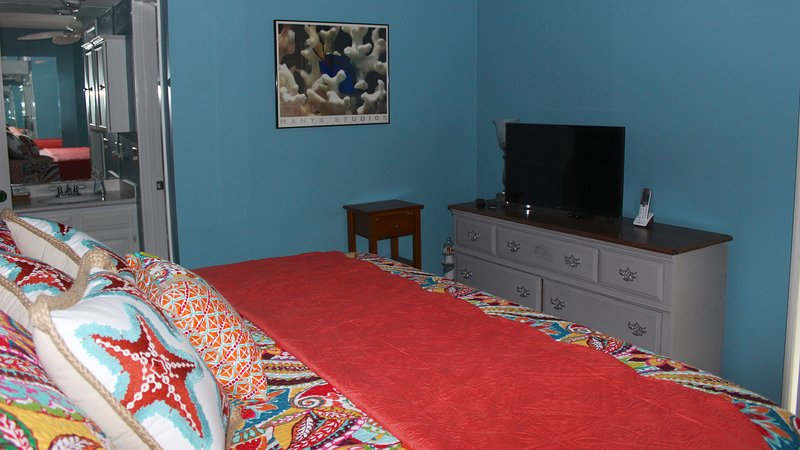 Watch the morning news on the HDTV atop the dresser. There is a sound machine and alarm clock for your use.