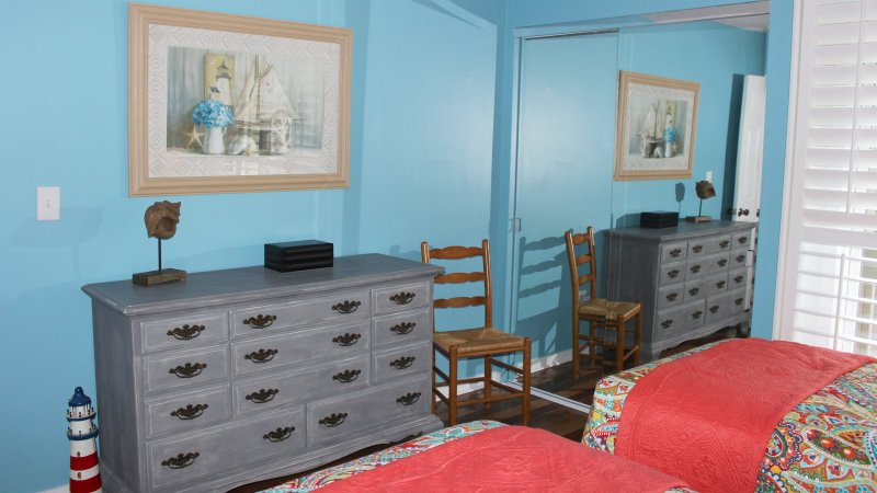 The large dresser will hold all your travel clothes. The closet also contains wardrobe accessories to help you stay organized and fresh.