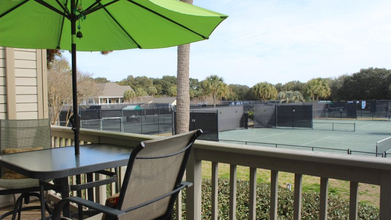 Enjoy watching the tennis matches being played from your very own deck.