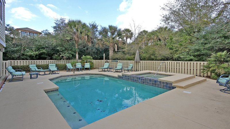 Relax poolside or walk to the beach on the boardwalk just beyond the fence.