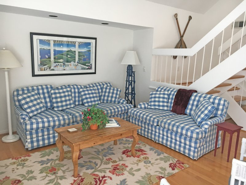 Enjoy the open living area. This bright home has hardwood floors and an inviting blue and white decor.