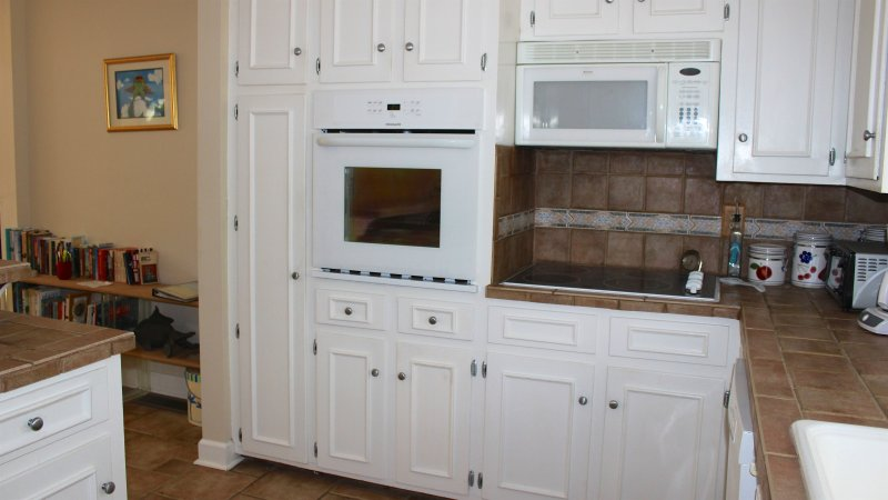The spacious kitchen has well stocked cabinets.