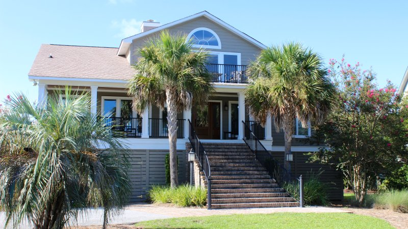This fabulous home is across the street from the beach and has great ocean and golf views.
