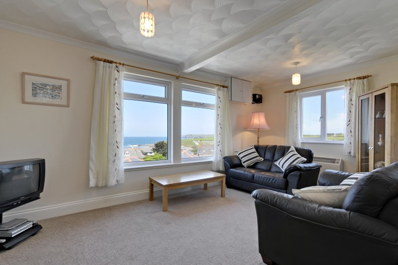 Lounge  with stunning sea views of Harlyn Bay