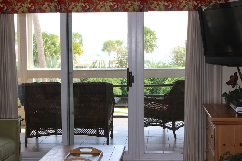Sliding doors in the living room and both bedrooms lead to the covered porch.