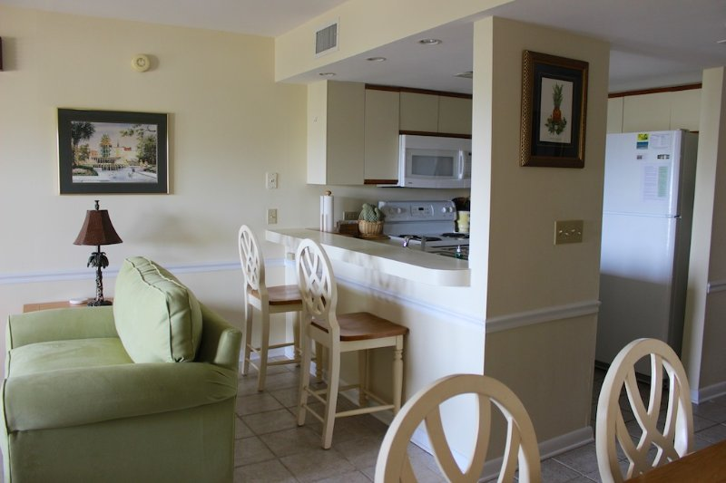 The kitchen is open into the living area allowing all to stay involved.