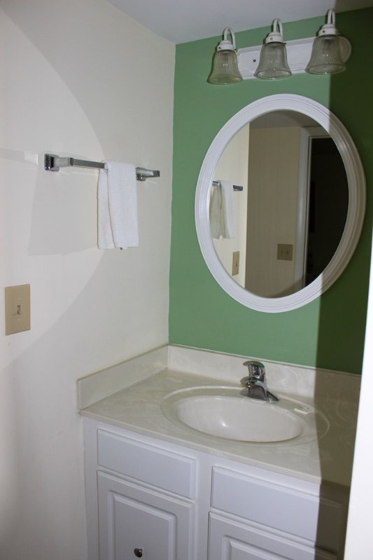 The master bath has a separate vanity area.