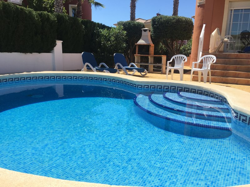 Beautiful private pool and patio area with 4 sun loungers, double sofa, parasol and patio set