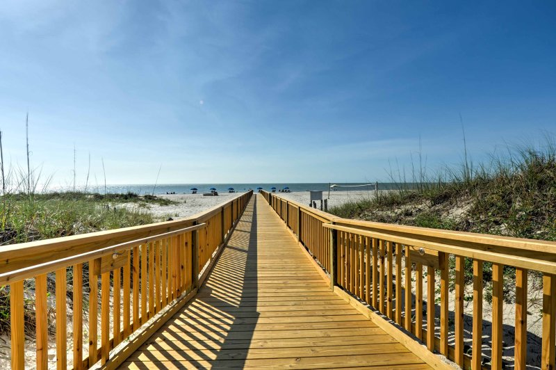 Enjoy easy access to the beach, just steps from the property!