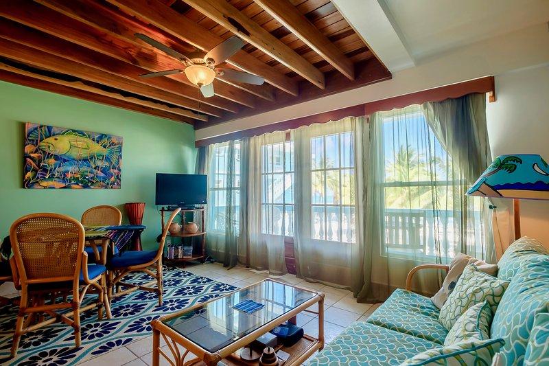 Living/dining area with double doors to balcony/veranda