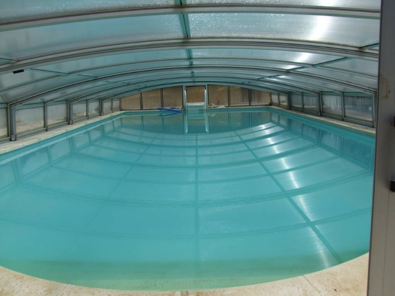 the large pool 5x10m is accessible all year round through the roof. The roof + sun = heating