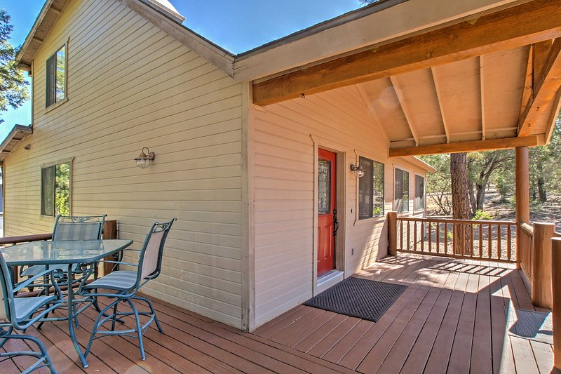 Enjoy sunbathing or lounging in the shade on this partially covered  wrap-around deck!