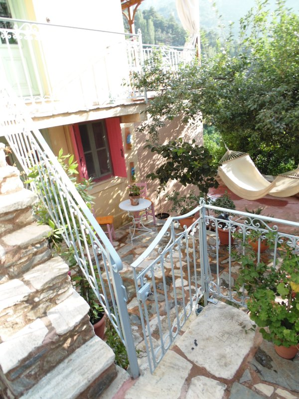 private garden and outdoor stairs to the 2nd level
