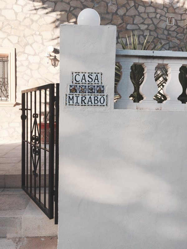 NAME OF VILLA ON WALL AT GATE ENTRANCE