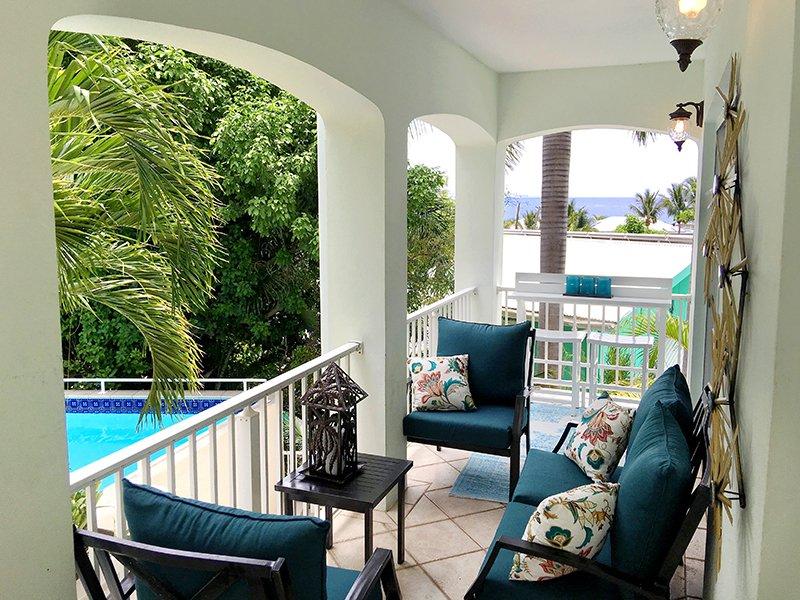 2-Balcony seating overlooking refreshing pool