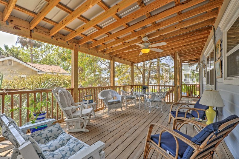 Escape the hustle and bustle of everyday life with this charming 3-bedroom, 2-bathroom Tybee Island house, which sleeps 9.