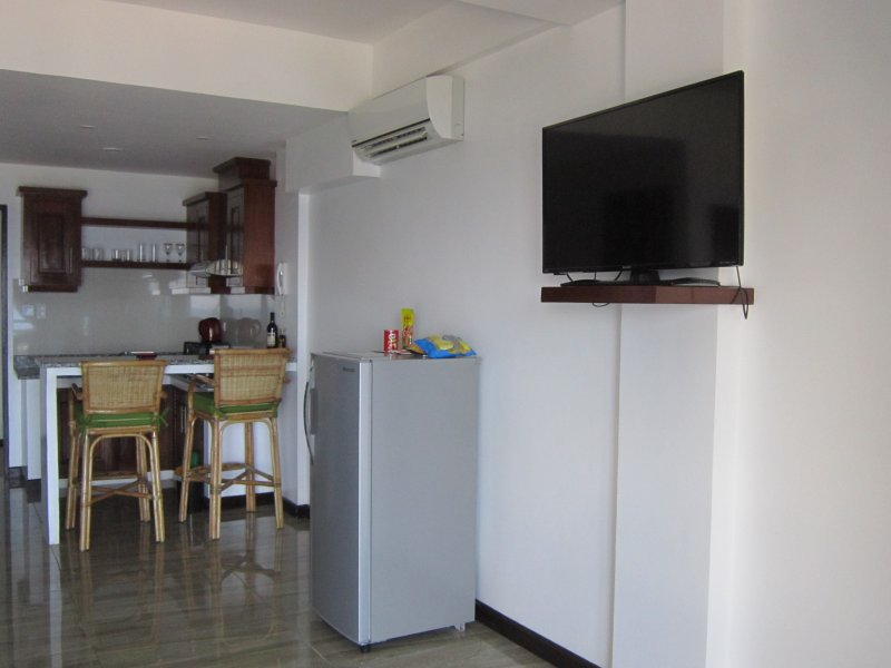 With refrigerator, flat screen tv and minibar.