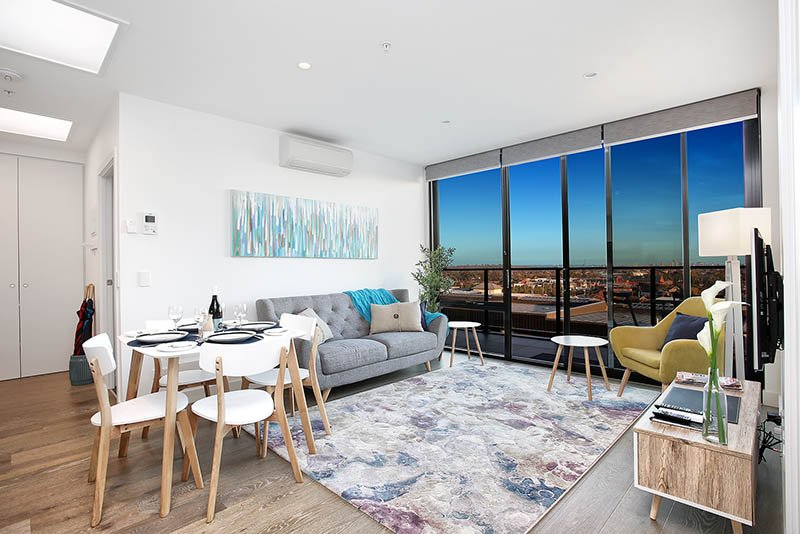 Living & dining area with expansive view of city and surroundings