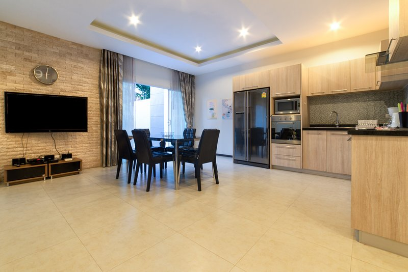 Kitchen is attached to living room, dining space