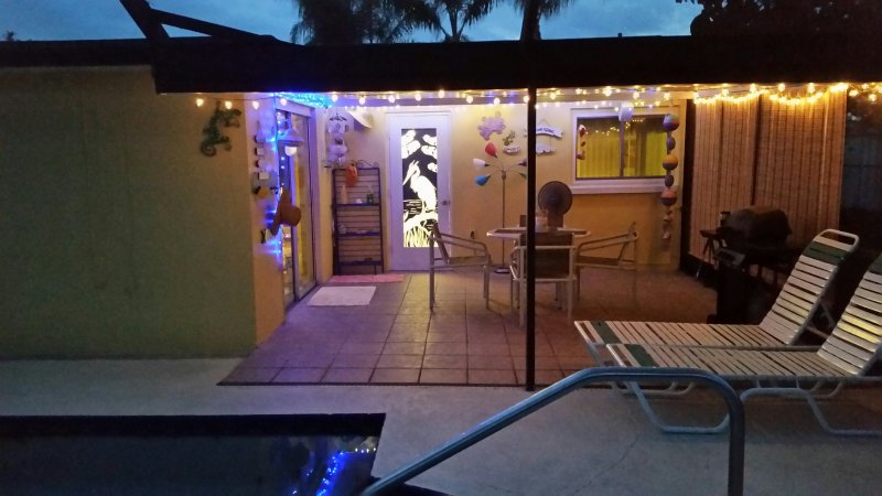 covered lanai with bbq grill