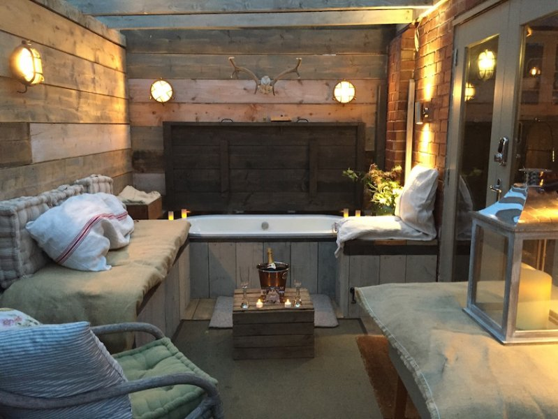 under glass roof outdoor roll top bath with outdoor fire complete wit champagne on ice! So romantic!