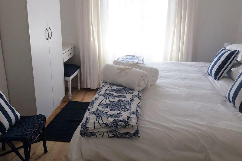 2. dormitorio camas individuales que han sido convertidos a un rey