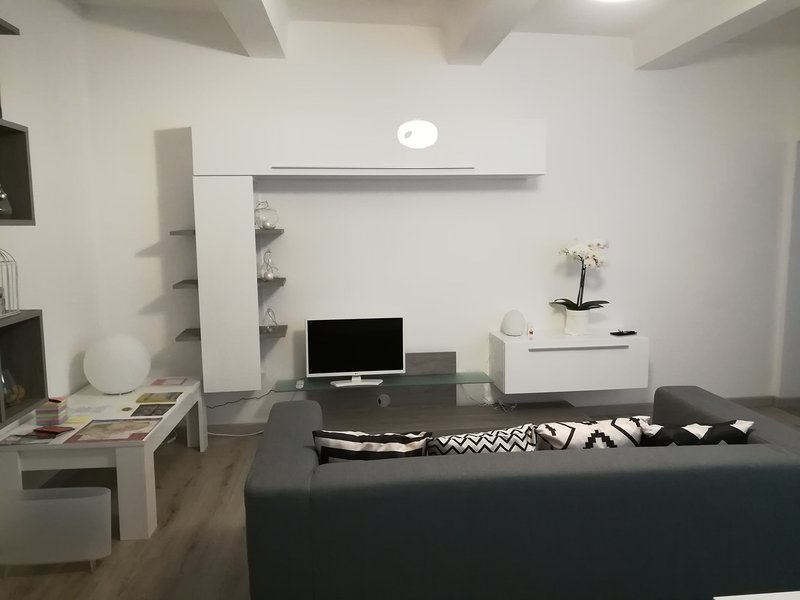 fitted wall in room with flat screen tv