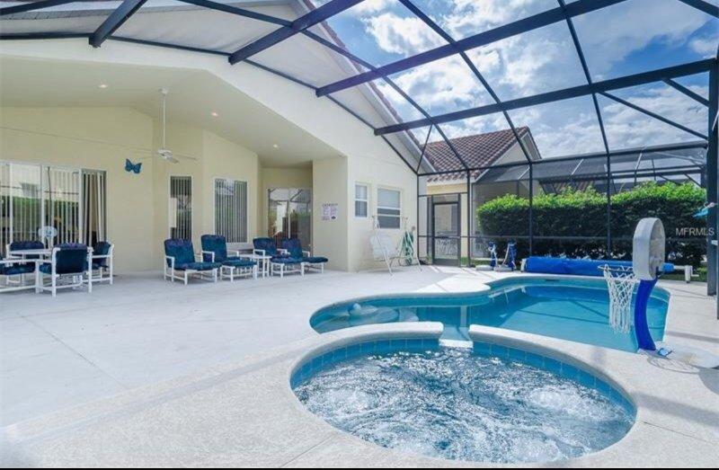 Heated pool and sauna covered with lanai screen.
