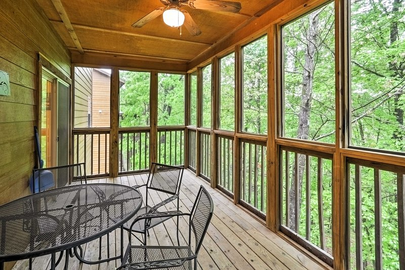 Sip morning coffee or enjoy a group meal out on the covered front porch surrounded by greenery.