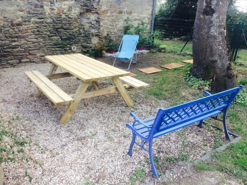 private garden at your disposal with outdoor table, deckchair and electric barbecue