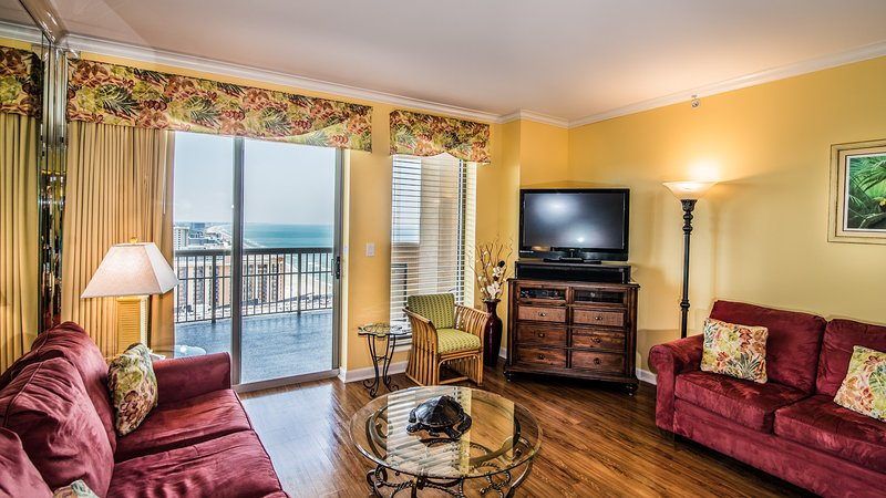 Sala de estar com acesso à varanda e vista costeira do norte