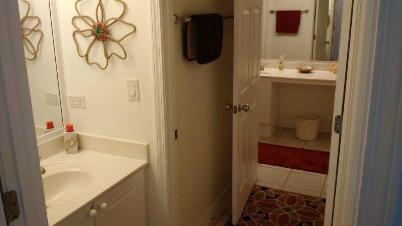 Looking from hallway through bath/shower