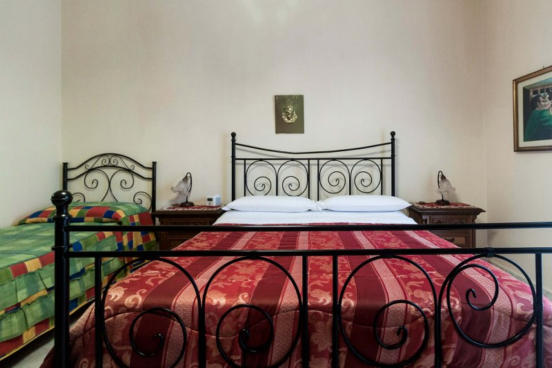 Bedroom 1: a double bed + 2 single beds