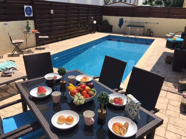Breakfast in the sun is one of the joys on holiday. Kids can be in the pool while mum & dad chill.