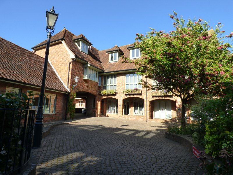 Secluded courtyard location situated just off the high street