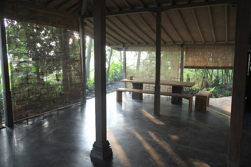 Open dining area with view towards the rice fields