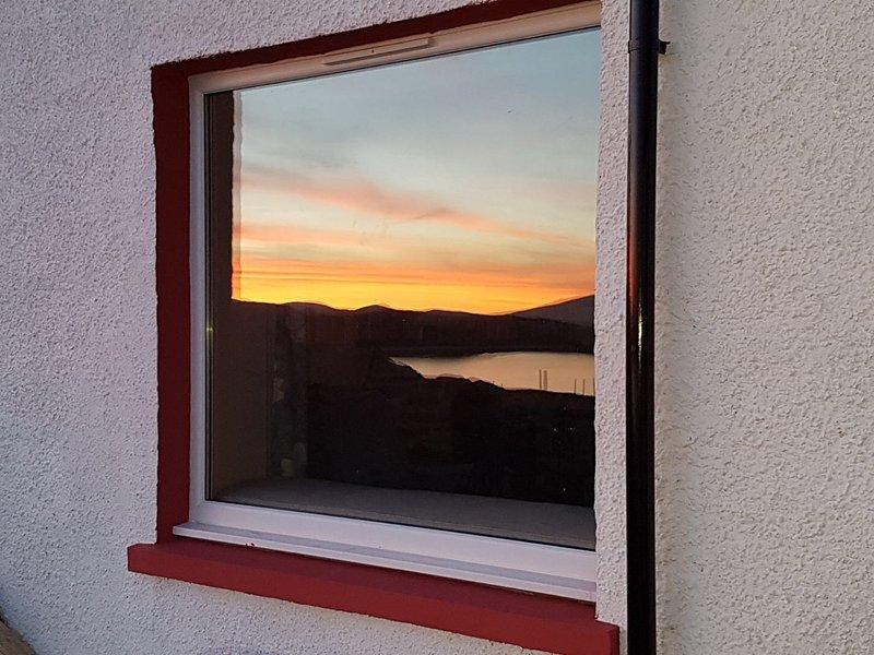 reflejo en la ventana del Salón