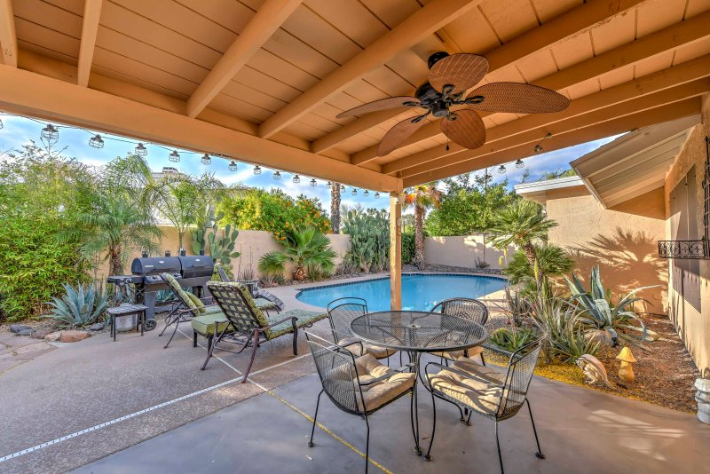 The backyard offers a peaceful and private oasis.