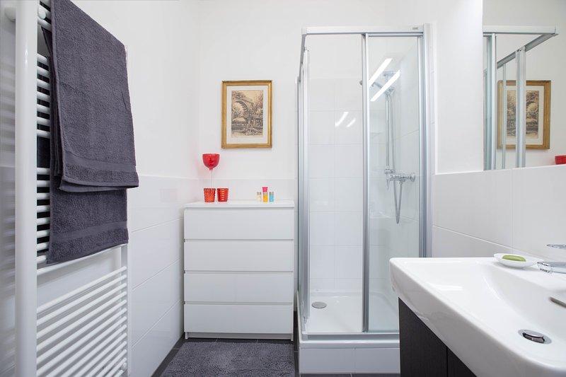En suite BATHROOM with cabin shower