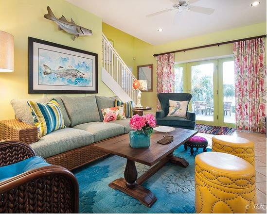 Beautifully furnished living room with French doors opening to the river view patio and deck.