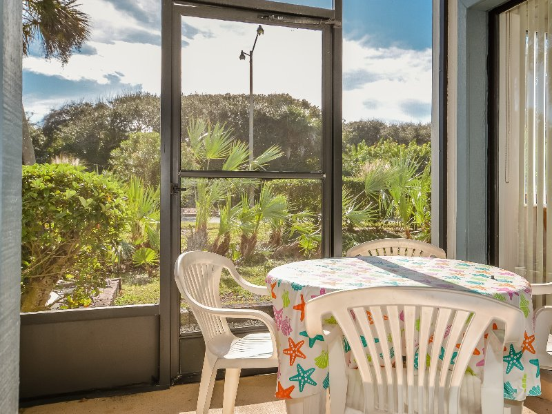 Relax in the Florida sunshine on the screened patio.